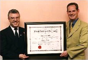 Pat Flood receiving his Certificate Of Embalming in 1997 from the Chairman Of the Irish Division